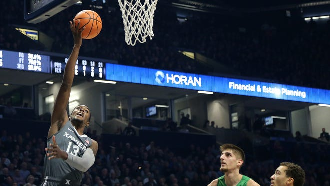 Xavier Musketeers forward Naji Marshall (13) goes up for a layup in the first half during the college basketball game between the Marshall Thundering Herd and the Xavier Musketeers, Tuesday, Dec. 19, 2017, at Cintas Center in Cincinnati.
