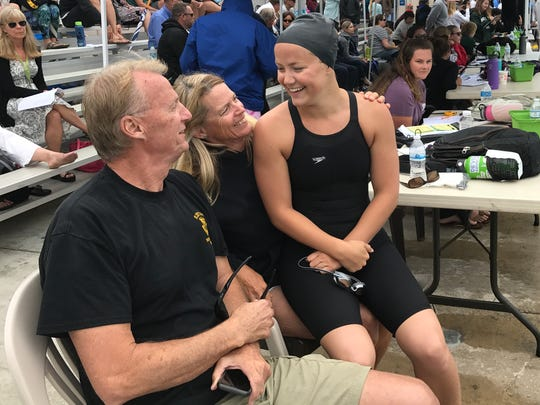 Ventura High senior Alicia Harrison is all smiles after winning two individual events at the Channel League swimming championships on Thursday at Buena High.