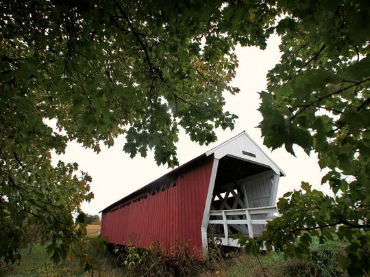 The Imes covered bridge just outside St. Charles is framed by trees in 2009. A trip to southwest Iowa should include famed bridges in Madison County.