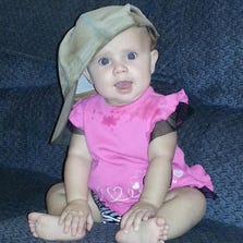 Billie Grace Warneke is 6 months old, a happy baby even with her first two teeth coming in.