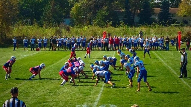 Players from Upsala/Swanville and Kimball line up at the line of scrimmage before a snap during Friday's game in Upsala.