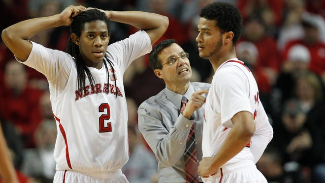Nebraska Cornhuskers head coach Tim Miles talks to guard Shavon Shields (31) and forward David Rivers (2) during the game against  the Illinois Fighting Illini in the first half at Pinnacle Bank Arena.