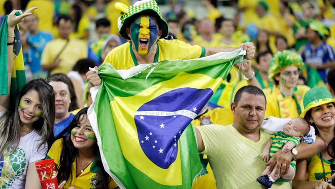 Brazil supporters celebrate following the World Cup quarterfinal soccer match between Brazil and Colombia at the Arena Castelao in Fortaleza, Brazil, Friday, July 4, 2014. Brazil defeated Colombia 2-1 to advance to the semifinals.