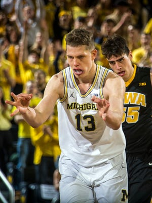 Moritz Wagner reacts after making a 3-pointer against Iowa in the first half at Crisler Center on Wednesday.