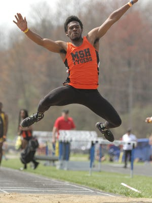 Two days after verbally committing to Minnesota in football, Mansfield Senior's Jornell Manns wins the long jump in Saturday's 85th Mehock Relays.