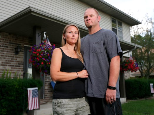 Heidi Sorrem and her husband Corey Sorrem, stand outside
