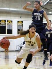 Alamogordo's Daniella Martinez drives toward the basket