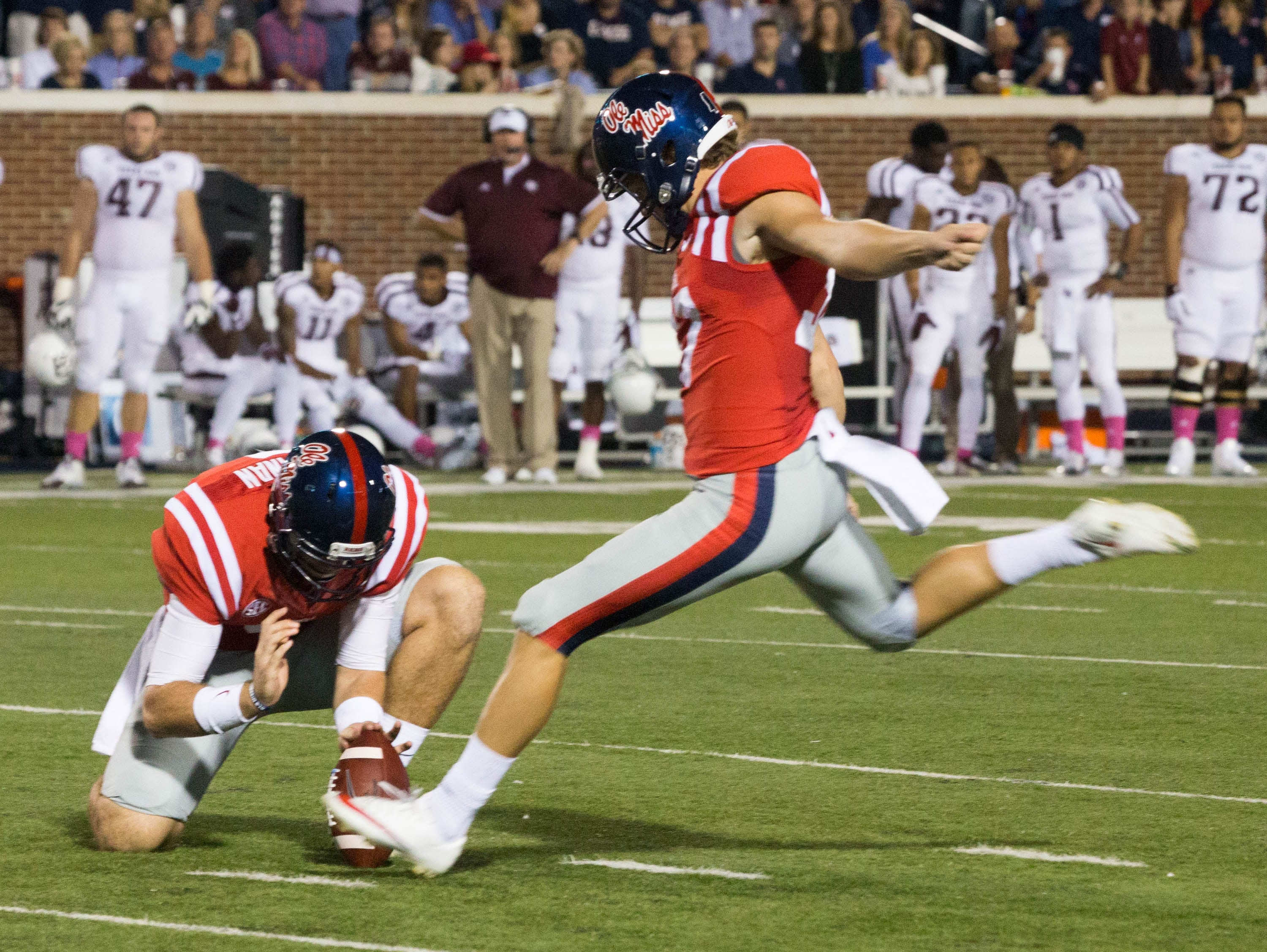 Ryan Buchanan holds for Gary Wunderlich who was 3-4 in field goals, scoring 9 points in the first half against Texas A&M.