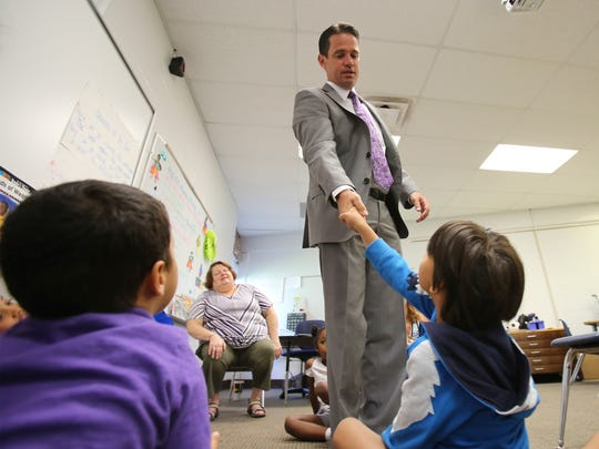Jefferson County Schools Superintendent Marty Pollio shakes the hand of a student attending a summer reading program at Cochran Elementary School in 2017.