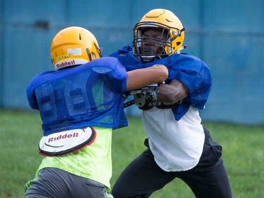 Manchester HighSchool football practice. Running back Lamont Lett.