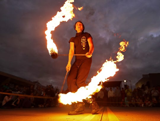 Ryan Ducham performs as part of a fire and flow show