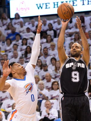 San Antonio Spurs guard Tony Parker (9) shoots against Oklahoma City Thunder guard Russell Westbrook (0) in Game 3 of the Western Conference semifinals.