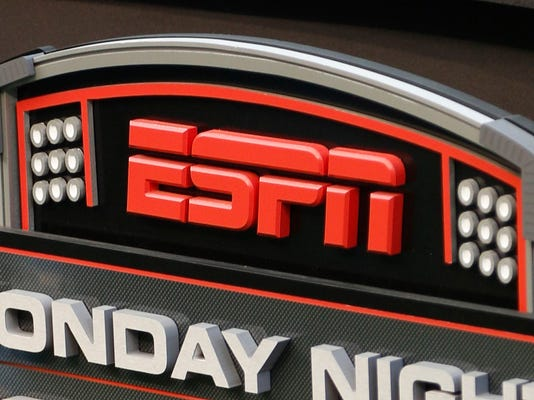 """FILE - This Sept. 16, 2013, file photo shows the ESPN logo prior to an NFL football game between the Cincinnati Bengals and the Pittsburgh Steelers, in Cincinnati. ESPN sideline reporter Sergio Dipp became an unlikely star of """"Monday Night Football"""" thanks to an awkward debut on the broadcast during the Denver Broncos-Los Angeles Chargers game on Sept. 11, 2017. (AP Photo/David Kohl, File)"""