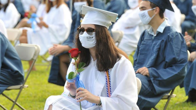 Katelyn Belyea holds a rose during the Pembroke High School graduation, Saturday, Aug. 8, 2020. Tom Gorman/For The Patriot Ledger