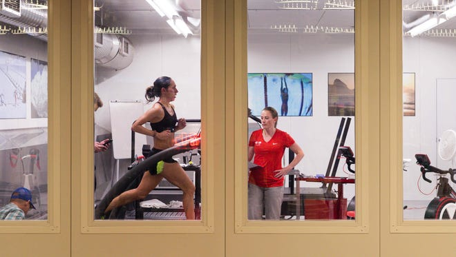May 25, 2016; Colorado Springs, CO, USA; USA Track and Field athlete Desiree Linden runs on a treadmill in a climate and oxygen controlled room during a media day held at the Olympic Training Center.