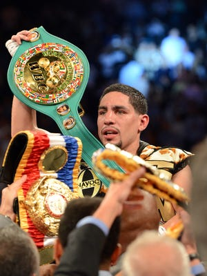 Danny Garcia, shown after beating Lucas Matthysse in September 2013,  will be the headliner in SiriusXM's initial boxing broadcast April 11 in Brooklyn.