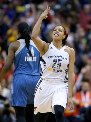 Indiana Fever guard Marissa Coleman (25) celebrates hitting a 3-pointer in the second half of their game. The Indiana Fever play the Minnesota Lynx in Game #4 of the WNBA Finals Sunday, October 11, 2015, evening at Bankers Life Fieldhouse.