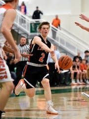 Central York's Garrett Markey passes the ball against Northeastern in the first half of the YAIAA boys' basketball title game Friday, Feb. 17, 2017, at York College. Northeastern defeated Central York 62-51 to win the championship.