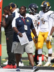 Detroit East English's coach Rod Oden on the sidelines