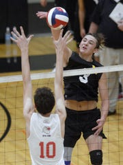 McQuaid's Calvin Spiteri, right, hits over the block of Penfield's Adam Johnson during a regular season game at McQuaid Jesuit High School on Wednesday, Sept. 20, 2017. McQuaid beat Penfield 3-1 (25-19, 26-24, 19-25, 25-17).