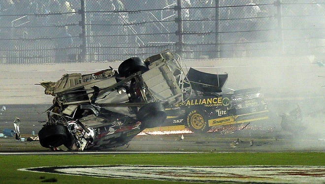 Austin Dillon's car comes to rest after crashing against the catch fence following the finish of the Coke Zero 400 at Daytona International Speedway.