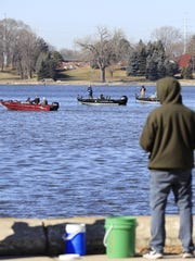 Boats full of fishermen are shown on the Fox river at Voyageur Park on Tuesday, Feb. 21, 2017, in De Pere.