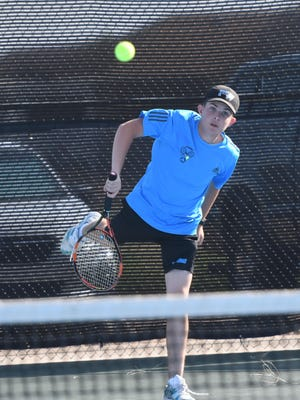 Pueblo West High School junior Will Dammann hits a serve during the No. 4 doubles match against Discovery Canyon on Sept. 11 at Pueblo West.