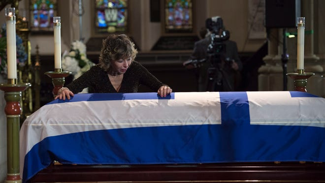 Renata Ford cries over her husband's casket at St. James Cathedral during funeral services in Toronto on March 30, 2016. Former mayor Rob Ford died the previous week of cancer.