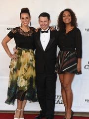 """Blayne Weaver poses with Erin Cahill (left) and Lyndie Greenwood while walking the red carpet for their film """"Cut to the Chase"""" which premiered Thursday evening at The Strand."""