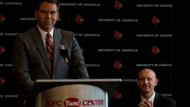 U of L athletic director Vince Tyra speaks during a press conference announcing Chris Mack, right, as head coach of Louisville Cardinals men's basketball team, at the Yum Center in Louisville, Ky, March 28, 2018.