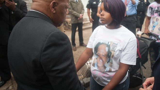 U.S. Rep. John Lewis talks to Meresa Carter, the mother of 8-year-old Gabby Hill-Carter, who was killed by a stray bullet in Camden. Carter and Lewis met in front of  753 Walnut St., a home where Dr. Martin Luther King Jr. stayed during the 1950s.