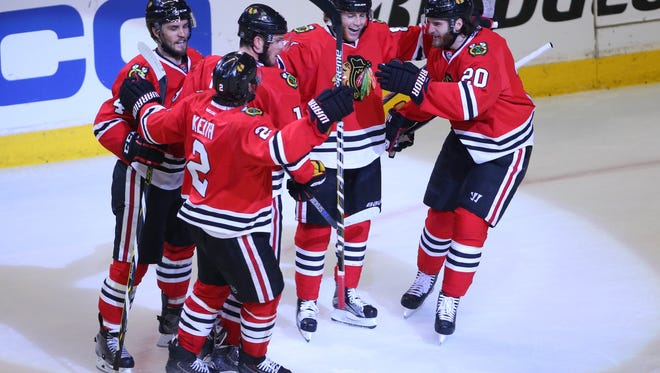 Chicago Blackhawks right wing Marian Hossa (81) celebrates with teammates Niklas Hjalmarsson (4) , Duncan Keith (2) , Jonathan Toews (19) and Brandon Saad (20) after scoring a goal against the Anaheim Ducks in the second period in game six of the Western Conference Final of the 2015 Stanley Cup Playoffs at United Center.