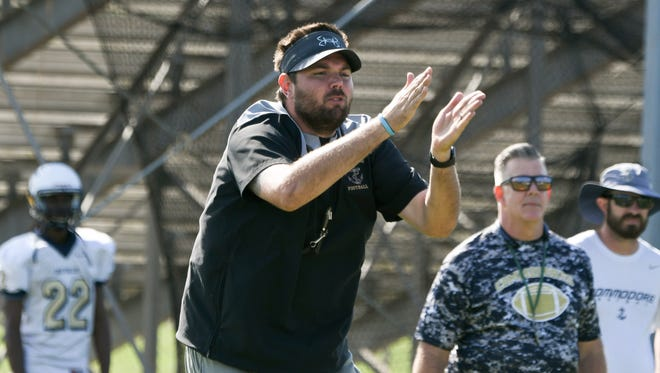 Eau Gallie football head coach Chris Sands directs his players during spring practice at the school.