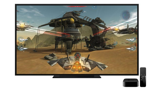 The new Apple TV Internet TV set-top box and remote showing a video game on-screen