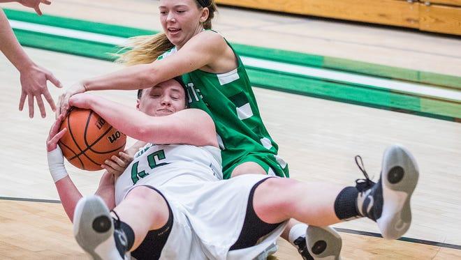 New Castle's Haylie Graham takes the ball from Yorktown's Jenna Irelan during their game at Yorktown High School Saturday, Dec. 5, 2015.