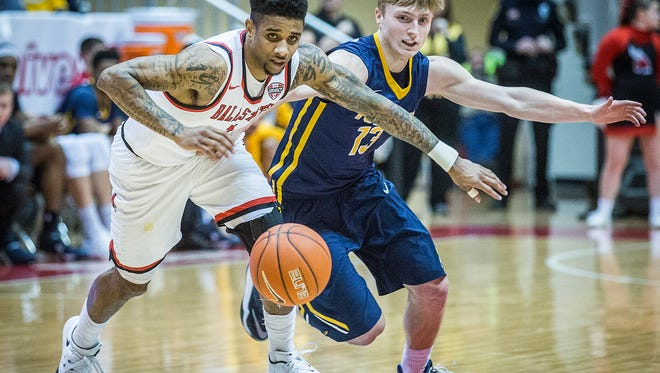 Ball State's Naiel Smith pulls away form Toledo's defense during their game at Worthen Arena Wednesday, Jan. 6, 2016.