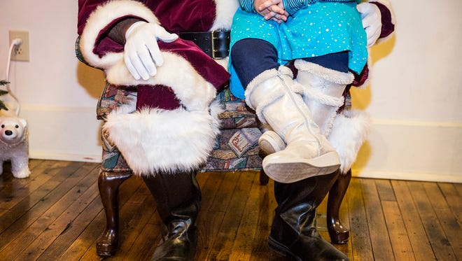 Hundreds of families lined up to meet Santa and receive a free gift during The Polar Express at the Wysor Street Depot Friday night.