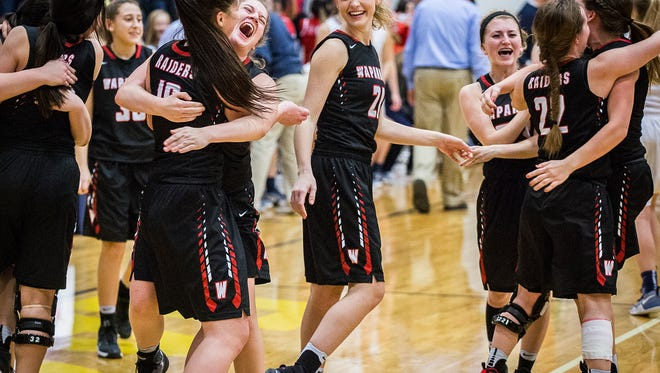 Wapahani celebrates defeating Delta during the Delaware County tournament championship game at Delta High School Saturday, Jan. 14, 2017.