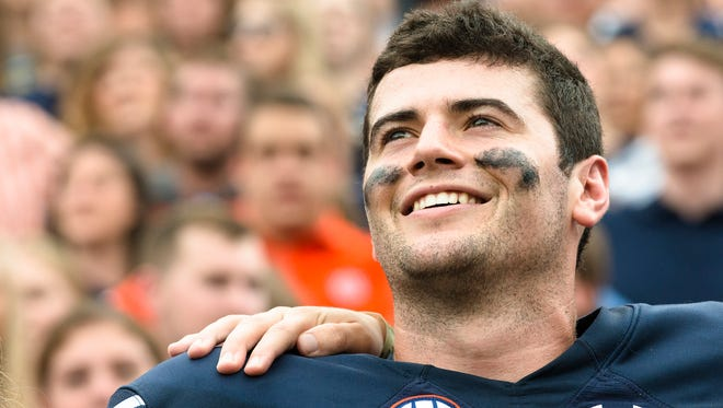 Auburn quarterback Jarrett Stidham (8) smiles while the Auburn Alma Matar is played after the NCAA football game between Auburn and Ole Miss on Saturday, Oct. 7, 2017, in Auburn, Ala. Auburn defeated Ole Miss 44-23.