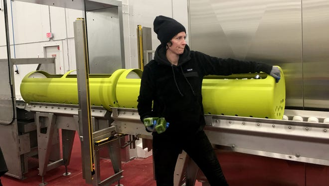 Great Lakes HPP Innovation Food Center in Taylor had a grand opening on Thursday, April 5, 2018. Jessie James co-founder of Drought raw juice company picks up products processed at Great Lakes HPP Innovation Food Center.