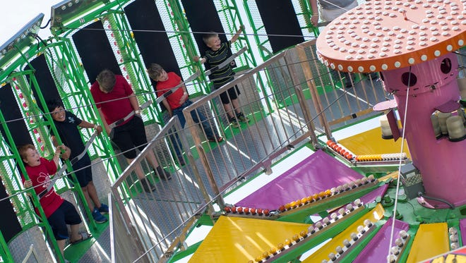 Kids ride the Zero Gravity ride Thursday, June 14, 2018, at Summerfest in Marysville.