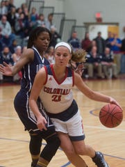 New Oxford's Kaelyn Long dribbles the ball past Dallastown's Sabria Royal during play on Friday, Dec. 23, 2016. Dallastown fell to New Oxford 48-44.