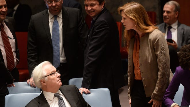 U.S. Ambassador to the U.N. Samantha Power talks with her Russian counterpart, Vitaly Churkin, before a vote on a resolution on Ukraine during a U.N. Security Council emergency meeting on March 15, 2014.