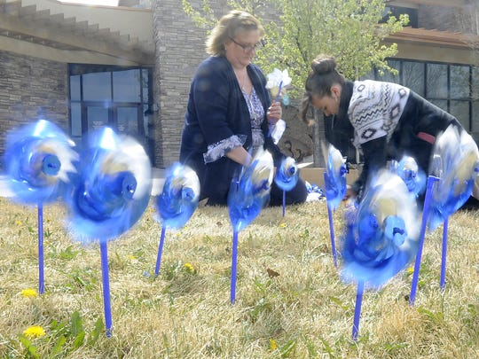 Pinwheels spin as employees place more on the front