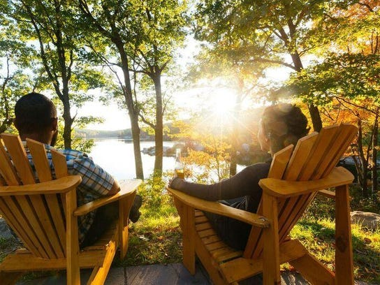 Guests relax while gazing at Breakneck Pond last year