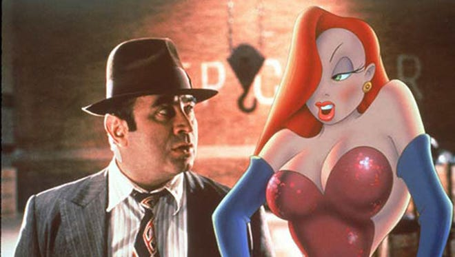 "Bob Hoskins, left, with Jessica Rabbit in ""Who Framed Roger Rabbit."" A collection of animation cels — frames from the film which include hand-drawn work and live-action images together — are on display this summer at the Trout Museum of Art in downtown Appleton."