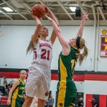 Marshall's Emily Delmotte (21) takes a shot against Pennfield on Feb. 5.