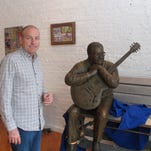 Jay Sieleman, president and CEO of The Blues Foundation, stands next to a statue of blues musician Little Milton at the Blues Hall of Fame museum in Memphis, Tenn. The foundation raised nearly $3 million for the museum, which opened Friday in Memphis.