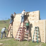 Members of the Brighton Rotary Raiders continue to build the Top of the Mountain obstacle course at Mt. Brighton Ski Area.