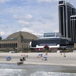This June 26, 2015 photo shows the shuttered Trump Plaza casino, right, in Atlantic City N.J. next to Boardwalk Hall, left. On Thursday July 9, 2015, a Delaware bankruptcy judge approved a deed restriction that owner Trump Entertainment Resorts had placed on the shuttered gambling hall, preventing anyone from operating it as a casino for at least 10 years.